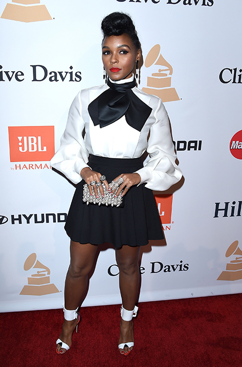 Janelle Monae carrying Box