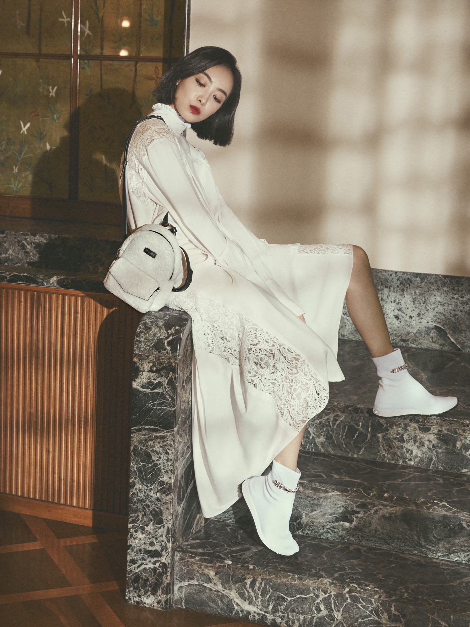 Victoria Song Qian carrying CASSIE bag and wearing REGENA trainers