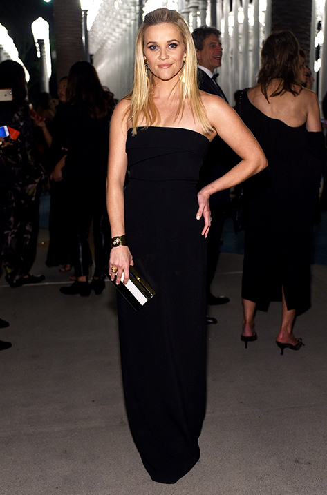 Reese Witherspoon carrying Box