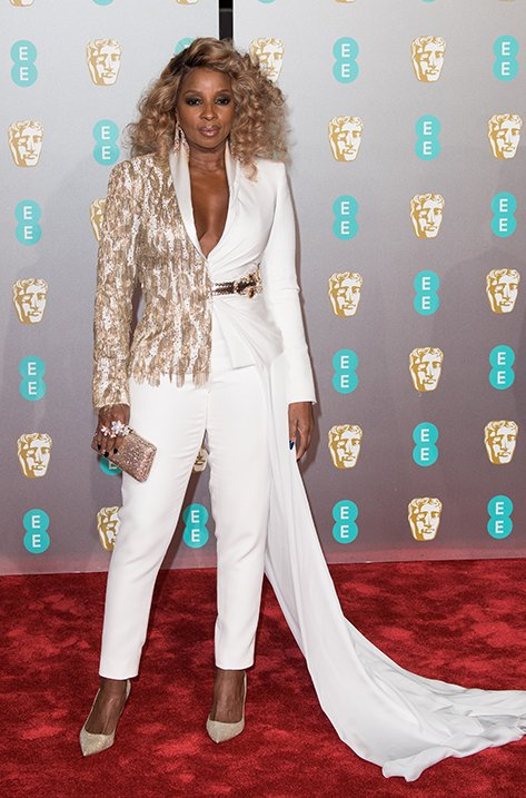Mary J Blige wearing ROMY and carrying CLEMMIE