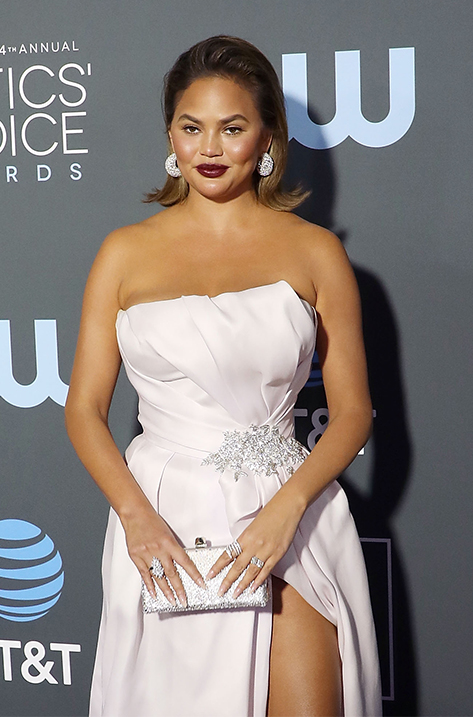 CHRISSY TEIGEN carrying CELESTE